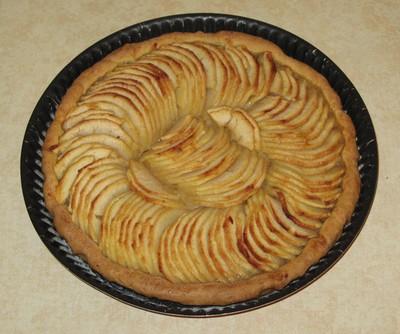 recette - tarte aux pommes avec sa couverture vanillée